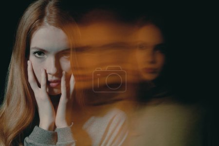 Photo for Pretty young redhead girl with anxiety disorder hiding her face, mental disorder concept - Royalty Free Image
