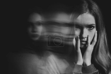 Photo for Black and white picture of scared beautiful young redhead woman with post traumatic stress disorder having sleep problems - Royalty Free Image