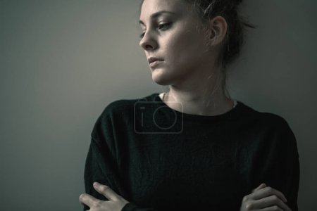 Photo for Portrait of young sad woman with anxiety disorder, anorexia ans loneliness concept - Royalty Free Image