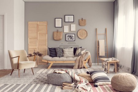 Photo for Stylish living room interior design with scandinavian settee, grey wall and natural accents - Royalty Free Image