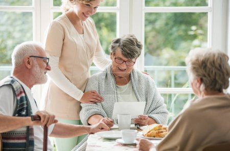 Photo for Senior friends spending time together at nursing home - Royalty Free Image