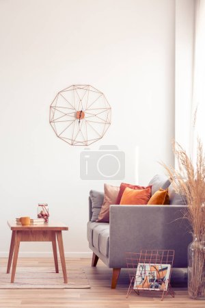 Photo for Fancy clock on white wall of elegant living room interior - Royalty Free Image