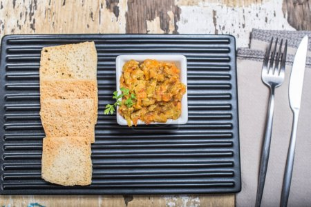 Photo for Snack toasts with vegetable spread on board on shabby wooden table - Royalty Free Image