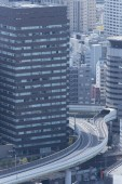 Highway and modern office building in Osaka city, Japan