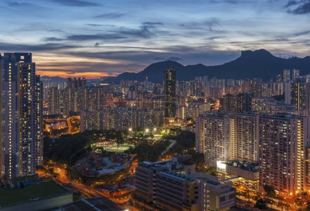 Photo for Panorama of Hong Kong City skyline and Lion Rock Hill at dusk - Royalty Free Image