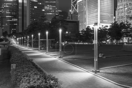 Photo for Promenade and skyline of Central district in Hong Kong city at night - Royalty Free Image