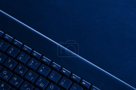 Photo for Laptop keys are tinted blue. Laptop keyboard tinted blue. - Royalty Free Image