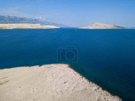 Aerial view of the coast of Croatia, headlands overlooking the sea, island of Pag. Overview of mountains and sea on the coasts of Croatia. Wild and uncontaminated nature. Transparent sea