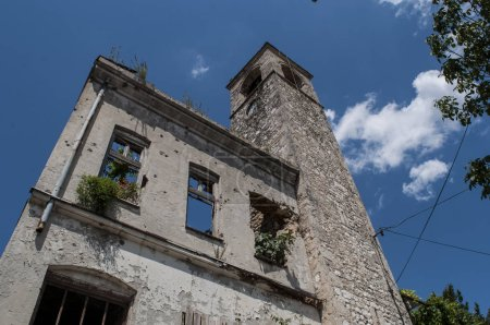 Bosnia, 06/07/2018: view of the Clock Tower (Sahat Kula), important example of the prolic Ottoman period, dated 1630, bombed and damaged during the Bosnian War (1992-1995)