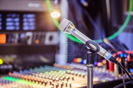 Photo for Metal microphone in the studio, cables and buttons in the blurry background - Royalty Free Image
