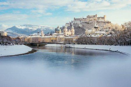 Panorama of Salzburg in winter: Snowy historical center, sunshin