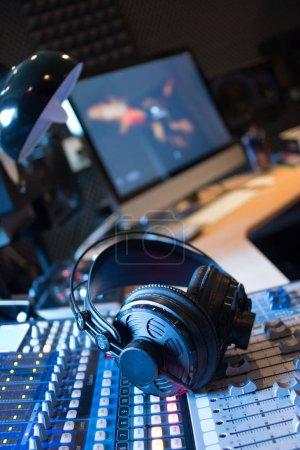 Photo for Professional sound recording studio: Headphones on a mixer desk, Radio - Royalty Free Image