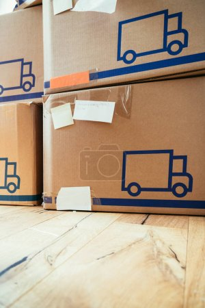 Photo for Move. Cardboard, boxes and stuff for moving into a new home - Royalty Free Image