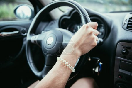 Photo for Female hands on a sports car steering wheel, car interior - Royalty Free Image