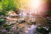 Beautiful landscape in Europe: Alpine River, waterfall and sunli