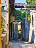 Desolate street with via and stone walls at San Giulio Island on