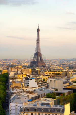 Aerial view of Paris skyline with Tour Eiffel in background.