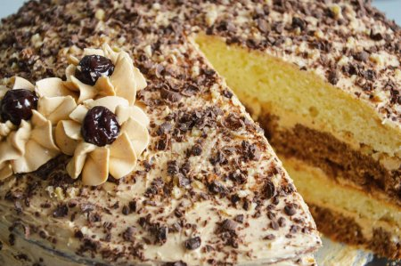Photo for Cream cake with chocolate chips and cream flowers - Royalty Free Image