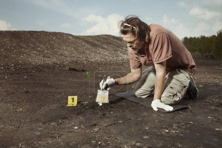 Uncovering of old human grave and skull on summer ...