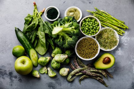 Photo for Healthy Green food Clean eating selection Protein source for vegetarians: asparagus, avocado, broccoli, spinach, spirulina, green peas on gray concrete background - Royalty Free Image