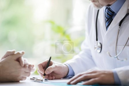 Doctor and patient taking notes in medical surgery