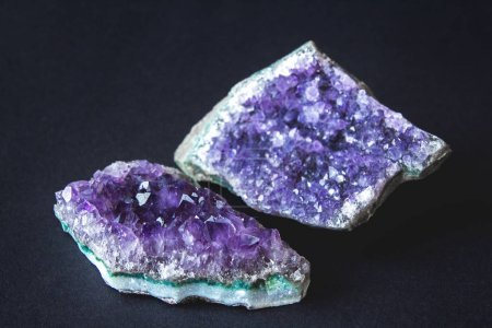 Close-up of amethyst stone druse crystals on dark ...