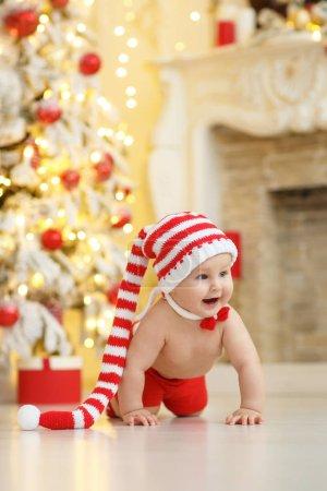 Baby boy near christmas tree
