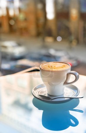 Photo for Cup of hot coffee on table in cafe - Royalty Free Image