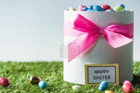 Photo for Gift box with pink bow full of multicolored Easter eggs isolated on white - Royalty Free Image