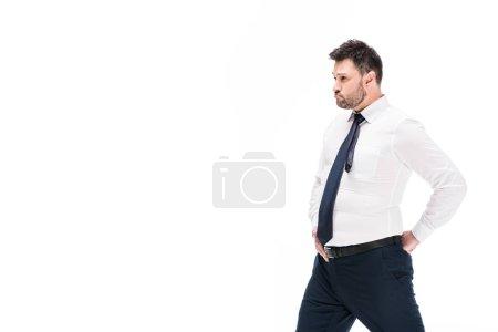 Foto de Overweight man in tight formal wear posing isolated on white with copy space - Imagen libre de derechos