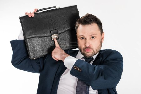 Photo for Chubby businessman holding briefcase and looking at camera isolated on white - Royalty Free Image