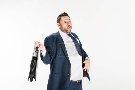 Photo for Surprised overweight businessman in tight formal wear holding briefcase isolated on white - Royalty Free Image