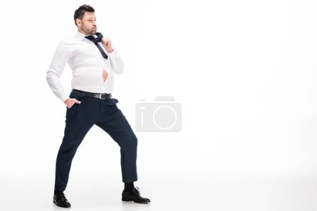 Photo for Overweight man in tight formal wear posing on white with copy space - Royalty Free Image