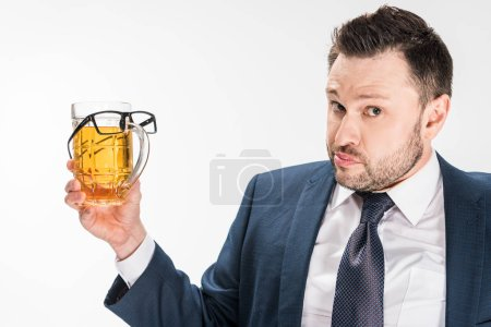 Photo for Chubby man in formal wear looking at camera while holding glass of beer with glasses on isolated on white - Royalty Free Image