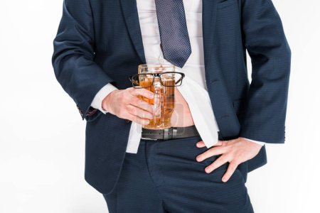 Photo for Cropped view of overweight man in formal wear holding glass of beer with glasses on isolated on white - Royalty Free Image