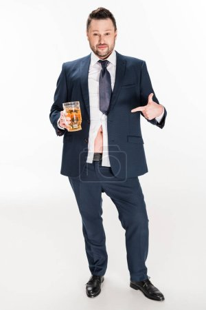 Photo for Overweight man in formal wear pointing with finger at glass of beer on white - Royalty Free Image