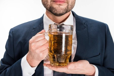 Photo for Cropped view of chubby man in formal wear holding glass of beer isolated on white - Royalty Free Image