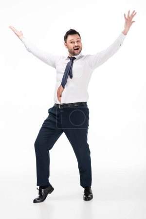 Photo for Happy overweight man in tight formal wear with outstretched hands on white - Royalty Free Image