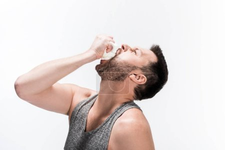 Photo for Chubby man in tank top eating marshmallows isolated on white - Royalty Free Image