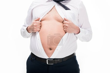 Photo for Cropped view of overweight man in tight formal wear showing belly isolated on white - Royalty Free Image