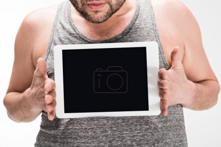 Photo for Cropped view of overweight man showing digital tablet with blank screen isolated on white - Royalty Free Image