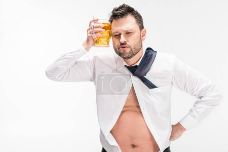 Photo pour Overweight man holding glass of beer near face isolated on white - image libre de droit