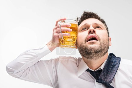 Photo for Chubby man holding glass of beer near face isolated on white - Royalty Free Image