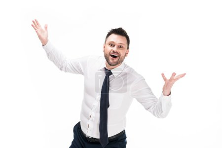 Photo for Happy overweight man in tight formal wear looking at camera and gesturing with hands isolated on white - Royalty Free Image