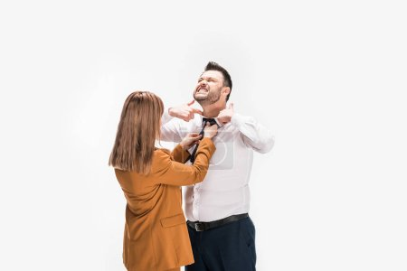 Foto de Woman in suit adjusting tie of overweight man pointing with fingers at neck isolated on white - Imagen libre de derechos