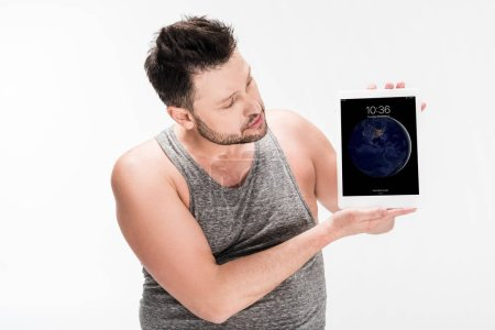 Photo for Overweight man showing digital tablet with apple home screen isolated on white - Royalty Free Image