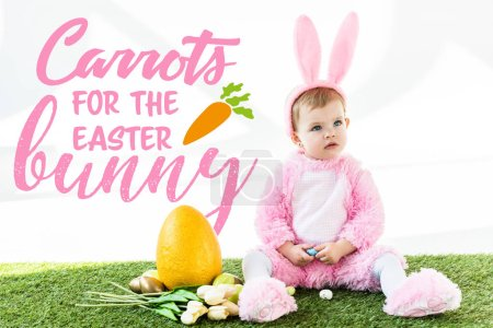 Photo pour Cute baby in bunny costume sitting near colorful chicken eggs, tulips and yellow ostrich egg with carrots for the Easter bunny illustration - image libre de droit