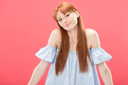 Photo for Redhead young woman looking at camera and showing shrug gesture isolated on pink - Royalty Free Image