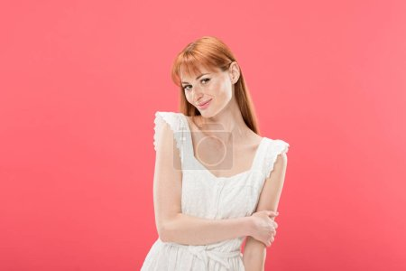 Photo for Smiling charming young redhead woman in white dress posing isolated on pink - Royalty Free Image