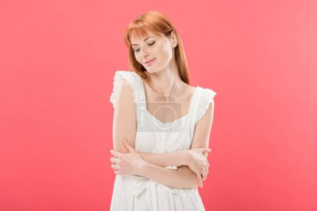 Photo for Charming young redhead woman in white dress posing isolated on pink - Royalty Free Image